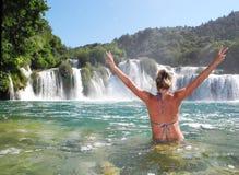 Skradinski buk, Croatia. The girl near the waterfall Skradinski buk, Croatia royalty free stock photos