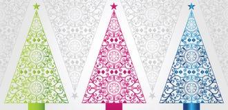 Skraj och eleganta julgranar Arkivbilder