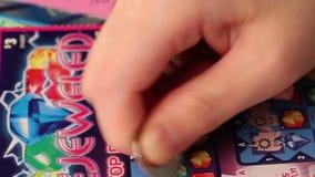 Skrapa lotterbiljetten lager videofilmer