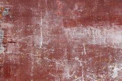 Skrapad röd metallyttersida Royaltyfri Foto