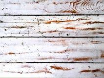 Skrapad vit målarfärg på träplankor Arkivbilder