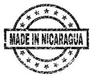 Skrapat texturerat GJORT I NICARAGUA stämpelskyddsremsa stock illustrationer