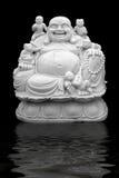 Skratta buddha med barn Arkivfoton