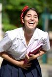Skratta den katolska colombianska flickastudenten Wearing School Uniform arkivbilder