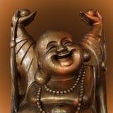 skratta för buddha figurine Arkivbild