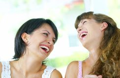 skratta för flickor Arkivfoto