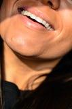 Skratta för kvinna royaltyfria foton