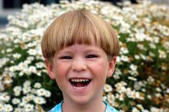 skratta för pojke Royaltyfria Foton