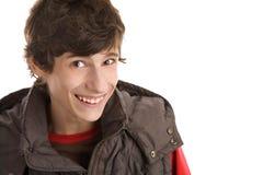 skratta för pojke som är tonårs- Arkivfoto