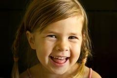 Skratta flicka Fotografering för Bildbyråer