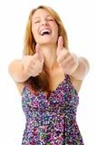 Skratta kvinna med två tum upp Arkivfoton