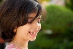 Skratta liten flicka Fotografering för Bildbyråer