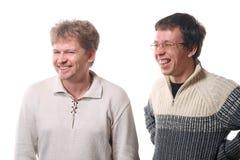 skratta män två barn arkivbilder