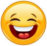 Skratta med den stängda ögonemoticonen Royaltyfri Foto