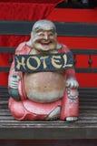 skratta tecken för buddha hotell Arkivfoto