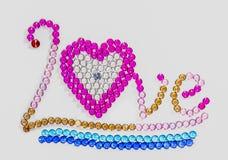 skrev förälskelse med färgrika diamanter Royaltyfria Bilder