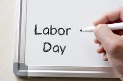 Skriftlig arbets- dag på whiteboard Arkivbilder