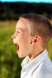 skrika för pojke Fotografering för Bildbyråer