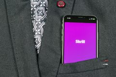 Skrill application icon on Apple iPhone X smartphone screen close-up in jacket pocket. Skrill app icon. Skrill is an online electr. Sankt-Petersburg, Russia stock photos