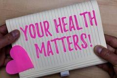Skriva anmärkningen som visar dina hälsofrågor Affärsfotoet som ställer ut fysisk Wellness, är den viktig stagpassformen och sunt royaltyfri fotografi