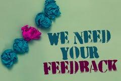 Skriva anmärkningsvisningen behöver vi din återkoppling Att ställa ut för affärsfoto ger oss dina granskningtankar kommentarer va arkivbild