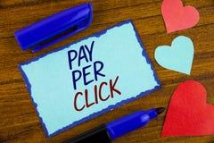 Skriva anmärkningsvisninglön per klick Att ställa ut för affärsfoto får pengar från besökareannonser som annonserar SEO Marketing royaltyfria bilder