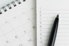 Skriva för att göra begreppet för lista- eller arbetsmålplan, svart penna inte på royaltyfri bild