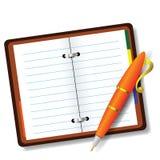 Skriva och anteckningsboken Arkivfoto