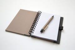 Skriva och anteckningsboken Royaltyfri Bild