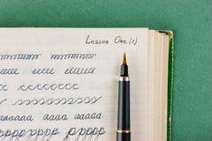 Skrivbok för gammal skola Arkivfoton