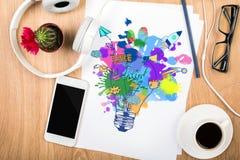 Skrivbord med den idérika lampteckningen Royaltyfria Bilder