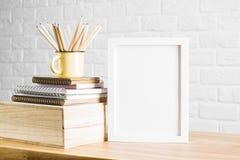 Skrivbord med den vita ramen och tillförsel royaltyfria foton