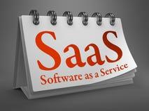 Skrivbords- kalender med SAAS-begrepp. Royaltyfri Fotografi