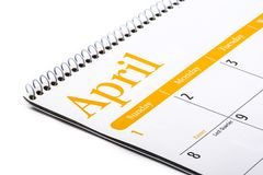 Skrivbords- kalenderApril slut upp på vit bakgrund Royaltyfri Fotografi