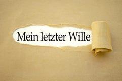 Skrivbordsarbete med de tyska orden för mitt sista skallr - meinletzter Wille arkivbild
