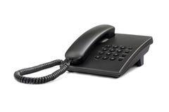 Skrivbordssvarttelefon med rundade knappar Närbild Royaltyfria Foton