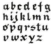 skriven alfabethand Arkivfoton