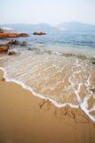 skriver det glada ordet för stranden xmas Royaltyfria Bilder