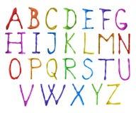 skrivet glass färgpulver för alfabet som befläckas Arkivbild