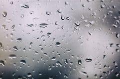skrivet h2o-raindropsfönster Royaltyfri Fotografi