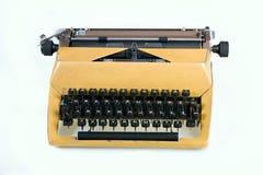 Skrivmaskin på en vit bakgrund arkivfoto