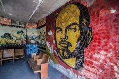 Skrunda in Latvia. Lenin mosaic in soldiers club building of abandoned former Soviet military town Skrunda in Latvia stock image