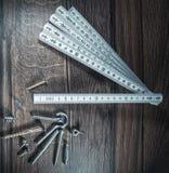 Skruv och konstruktionsmeter Royaltyfria Bilder