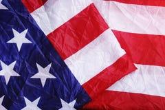 Skruvad upp USA flaggabakgrund Arkivfoto