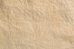 Skrynklig gammal pappers- bakgrund och texturen arkivfoto