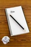 Skrynklig papper och blyertspenna med anteckningsboken Royaltyfria Foton