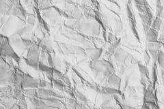 Skrynklig vitbok som en bakgrund Fotografering för Bildbyråer
