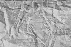 Skrynklig vitbok som en bakgrund Arkivfoto