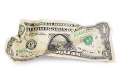Skrynkliga de isolerade dollarräkningarna Arkivbild
