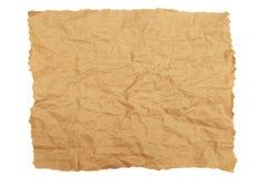 Skrynkligt brunt kraft papper med sönderrivna kanter fotografering för bildbyråer